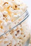 Bowl of popcorn. Closeup of glass bowl of popcorn stock photography