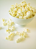 Bowl of popcorn. Buttered popcorn in white bowl, on white background royalty free stock photo