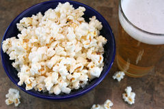 Bowl of popcorn and beer Stock Photos