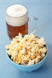 Bowl of popcorn and beer Stock Image