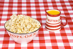 Bowl of popcorn with cup of melted butter Stock Photos