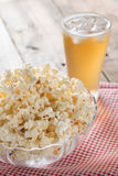 Bowl of popcorn with glass beer. Royalty Free Stock Images