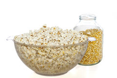 Bowl of popcorn and jar of popcorn seeds Royalty Free Stock Photos