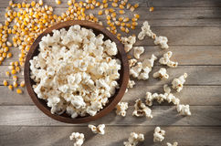 Bowl Popcorn Kernels Food. A bowl of popcorn with some un-popped kernels on a rustic wood table Royalty Free Stock Photo