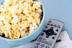 Bowl of popcorn and remote control Royalty Free Stock Photo