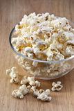 Bowl Popcorn Snack Food. A bowl ofPopcorn on a wood table Royalty Free Stock Images