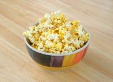 Bowl of popcorn on tabletop Stock Photos