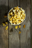 Bowl with popcorn on wooden background. View from above royalty free stock image