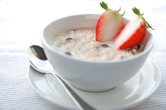 Bowl of Porridge. With strawberry and dry nuts,healthy oatmeal breakfast Royalty Free Stock Images