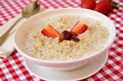 Bowl with porridge Stock Photos