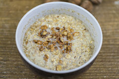 Bowl of porridge with healthy nuts Stock Photo