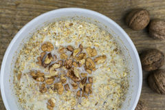Bowl of porridge with healthy nuts Stock Image