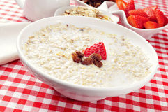 Bowl with porridge on a set table for breakfast Royalty Free Stock Photos