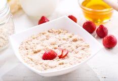 Bowl of porridge with strawberry Stock Photography