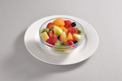 Bowl with a portion of mixed fruit salads Stock Photo
