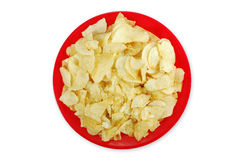 Bowl of Potato Chips. A bowl of greasy potato chips piled high Royalty Free Stock Photo
