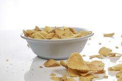 Bowl of potato chips. On white background Royalty Free Stock Images
