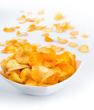 Bowl of potato chips on white background Stock Images
