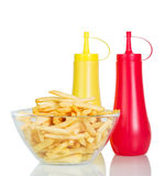 Bowl of potato fries, ketchup and mustard isolated on white. Stock Photography