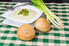 Bowl of potato leek soup with rolls Royalty Free Stock Photography