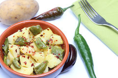 Bowl with potatoes and chili pepper Royalty Free Stock Image
