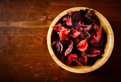 Bowl of potpourri  on dark wooden table. Top view Royalty Free Stock Photo