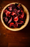 Bowl of potpourri  on dark wooden table. Top view Royalty Free Stock Images