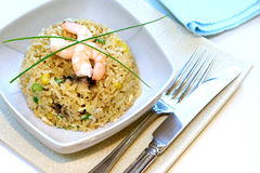 A bowl of prawn, mushroom and egg stir fried rice. Garnish with chives Royalty Free Stock Image