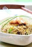 A bowl of prawn, mushroom and egg stir fried rice Royalty Free Stock Images