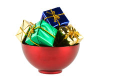 Bowl of presents alpha. Red bowl filled with wrapped presents stock photography
