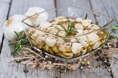 Bowl with preserved Garlic Stock Photography