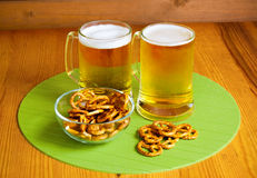 Bowl of pretzels and  two mugs of beer Stock Image