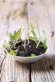 Bowl of prunes Royalty Free Stock Images