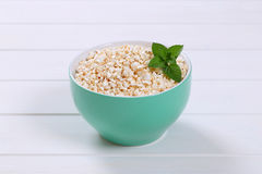 Bowl of puffed buckwheat Stock Photo
