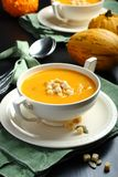 Bowl of pumpkin soup with bread crouton Stock Images