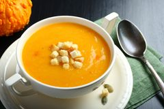 Bowl of pumpkin soup with bread crouton Royalty Free Stock Photography