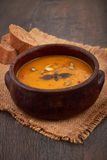 Bowl of pumpkin soup with bread Royalty Free Stock Images