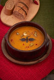 Bowl of pumpkin soup with bread Stock Photos