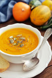 Bowl of pumpkin soup Stock Images