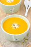 Bowl of pumpkin soup with ginger, top view Stock Images