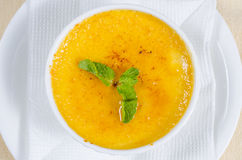 Bowl of pumpkin soup with mint Royalty Free Stock Images