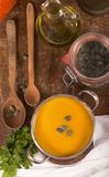 Pumpkin soup on rustic wooden background Royalty Free Stock Photo