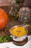 Pumpkin soup on rustic wooden background Royalty Free Stock Photography