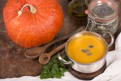 Pumpkin soup on rustic wooden background Stock Image