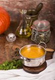 Pumpkin soup on rustic wooden background Stock Photography