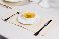Bowl of pumpkin soup served at table Royalty Free Stock Image