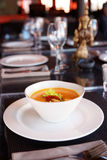 Bowl of pumpkin soup on table Stock Image