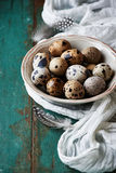 Bowl of quail's eggs on old painted table Royalty Free Stock Images