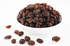 Bowl of raisin on white Stock Photos