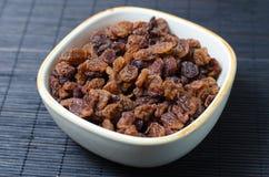 Bowl of raisins on dark background Stock Photos